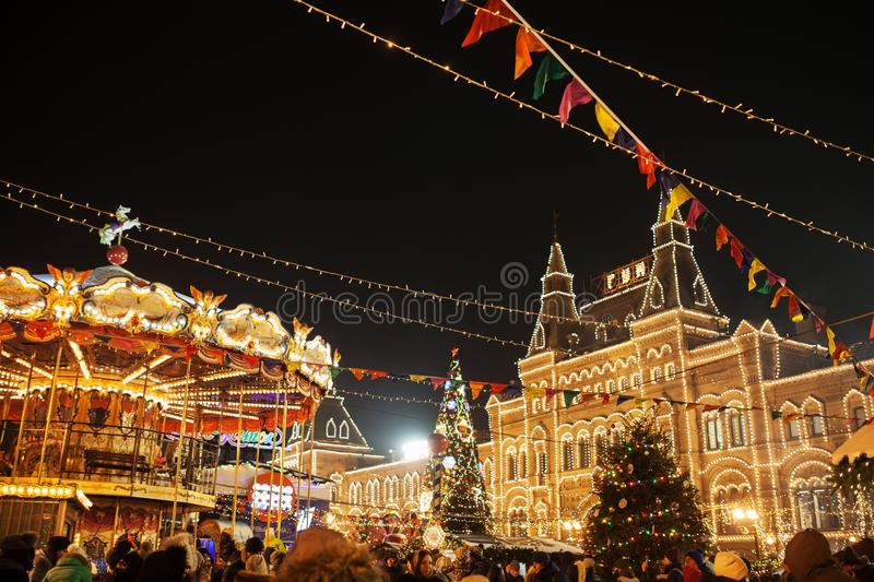 Celebration lights and decorations on Red Square for festive Christmas and New Year. Shining yellow lights on facade GUM in Moscow royalty free stock photos