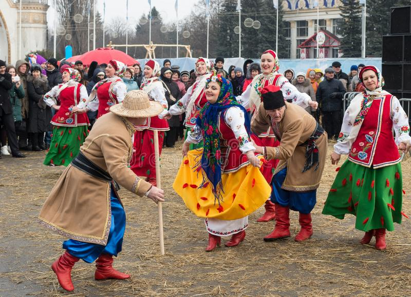 The celebration of the Maslenitsa Shrovetide in the city. .Traditional dances and games in folk costumes stock photo