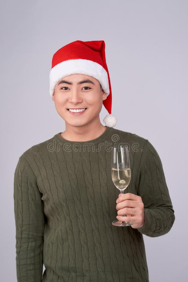 Celebration and New Year. Asian man holds glass of champagne stock photo