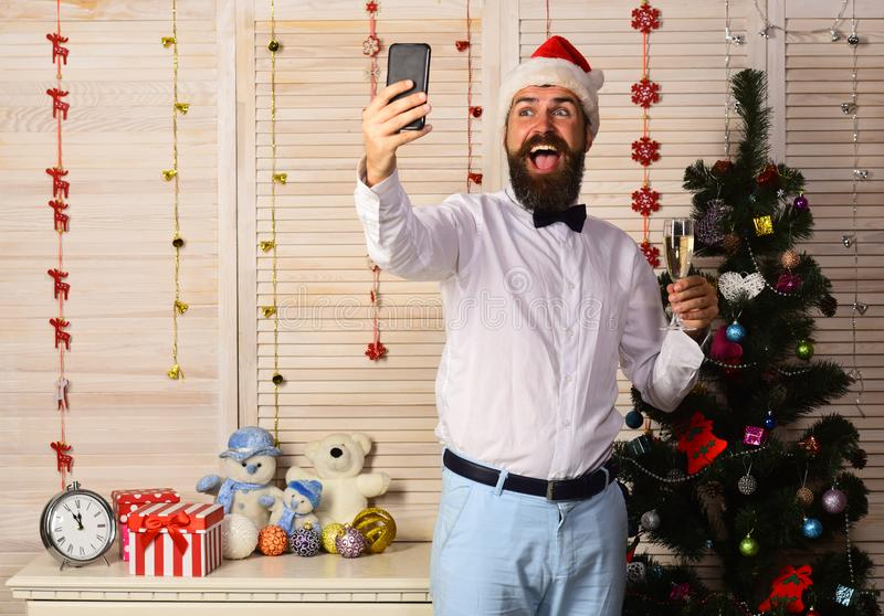 Celebration and New Year greeting concept. Man with beard royalty free stock photography