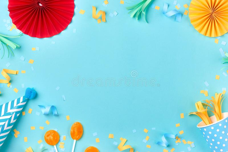 Celebration pattern with various party confetti on blue background. Flat lay royalty free stock images