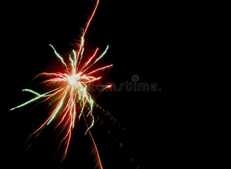 During the celebration, people fireworks, fireworks, and firecrackers. everyone enjoys colorful flashes in the night sky. The glow is bewitching. sparks slowly stock photos