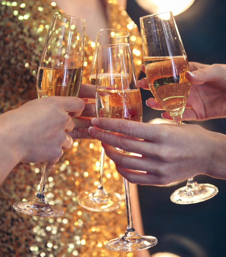 Celebration. People holding glasses of champagne making a toast. DOF. Natural light. Photo in motion. Toned image royalty free stock image