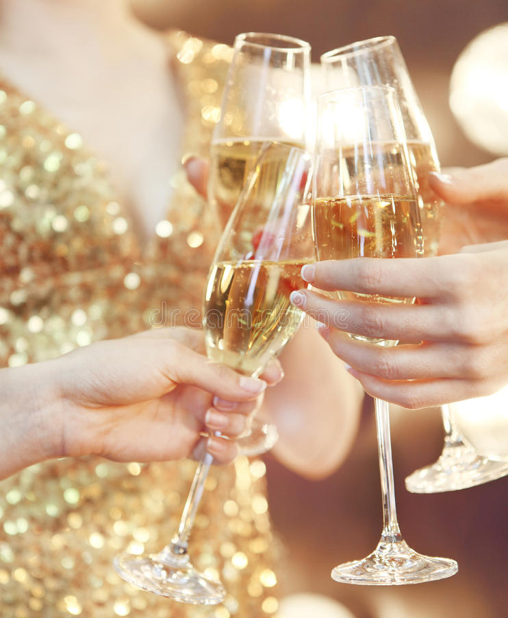 Celebration. People holding glasses of champagne making a toast. Celebration or party. People holding glasses of champagne making a toast royalty free stock images