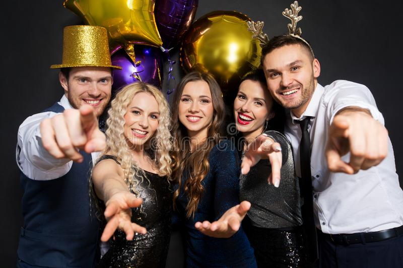 Friends at christmas or new year party stock images