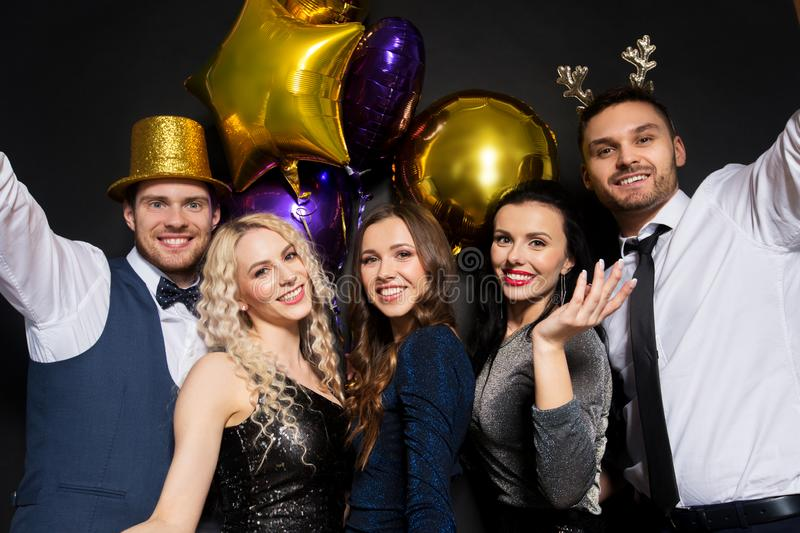 Friends at christmas or new year party royalty free stock photos