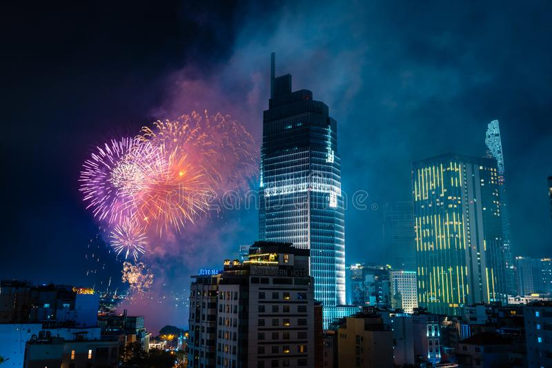 Ho Chi Minh City, Vietnam,february 4, 2019: Lunar New Year celebration. Skyline with fireworks light up sky over business district stock images