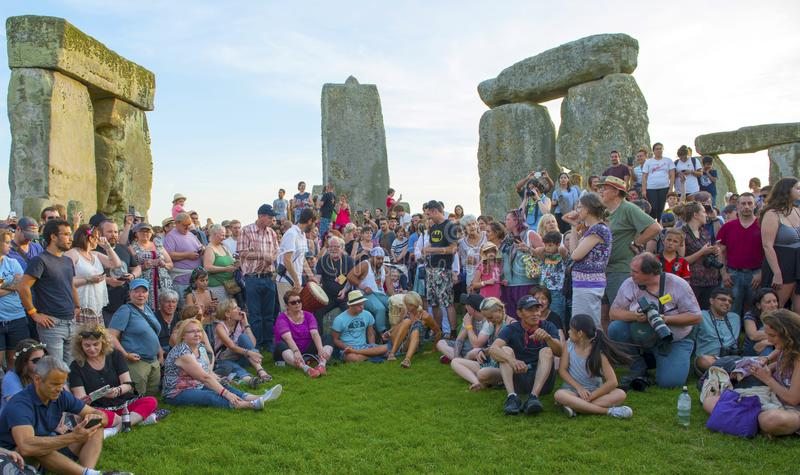 Stonehenge Summer Solstice. Celebrants at ruins of Stonehenge Wiltshire Summer Solstice observation on sunny day royalty free stock photos