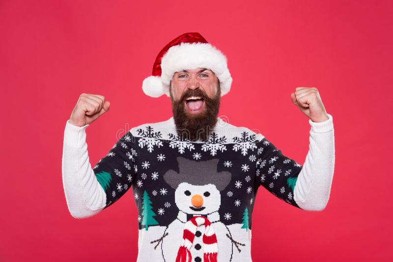 Celebration time. Emotional man Santa hat celebrate new year. Traditional celebration. Feeling awesome successful royalty free stock images
