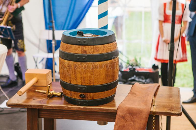 Celebration of the traditional German beer festival Oktoberfest. The beer barrel is a holiday symbol before its breaking. As a traditional holiday start royalty free stock photos