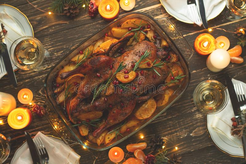 A celebration of the traditional Thanksgiving Day celebration. Flat-lay dinner for the family with roasted duck or chicken on a stock photos