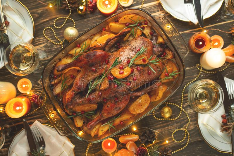 A celebration of the traditional Thanksgiving Day celebration. Flat-lay dinner for the family with roasted duck or chicken on a royalty free stock photos