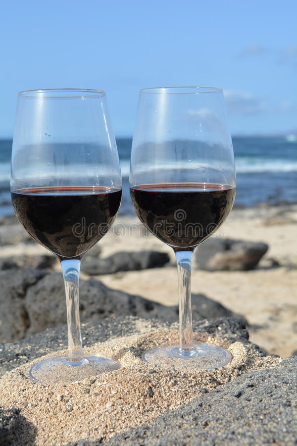 Celebration With Two Glasses Of Red Wine On The Ni stock image