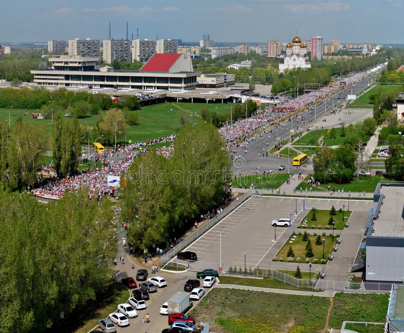 Celebration of Victory Day.  Thousands of people took to the main street to participate in the action Immortal Regiment. stock photo