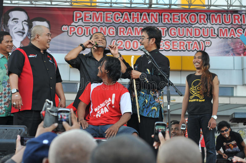 Celebration the victory of Presidential Candidate Joko Widodo. Supporters shave hair to bald to celebrate the victory of Presidential Candidate Joko Widodo in stock photo