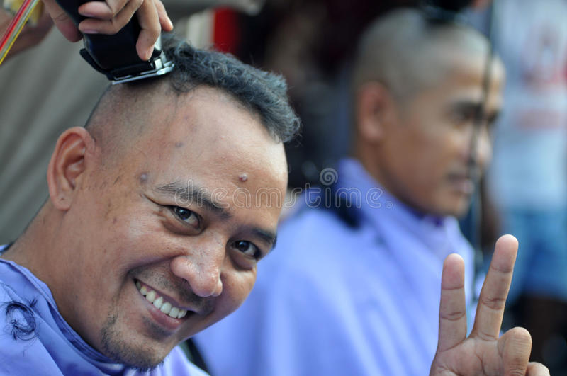 Celebration the victory of Presidential Candidate Joko Widodo. Supporters shave hair to bald to celebrate the victory of Presidential Candidate Joko Widodo in stock photos