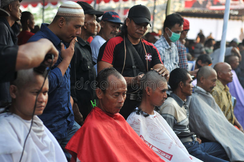 Celebration the victory of Presidential Candidate Joko Widodo. Supporters shave hair to bald to celebrate the victory of Presidential Candidate Joko Widodo in royalty free stock photo