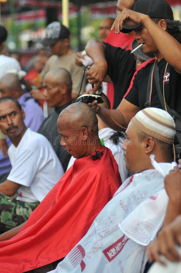 Celebration the victory of Presidential Candidate Joko Widodo. Supporters shave hair to bald to celebrate the victory of Presidential Candidate Joko Widodo in royalty free stock photography