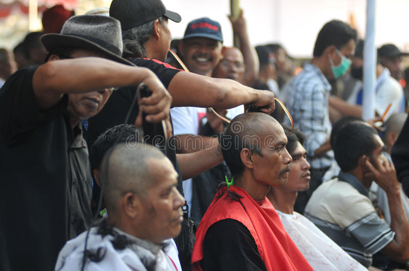 Celebration the victory of Presidential Candidate Joko Widodo. Supporters shave hair to bald to celebrate the victory of Presidential Candidate Joko Widodo in stock images
