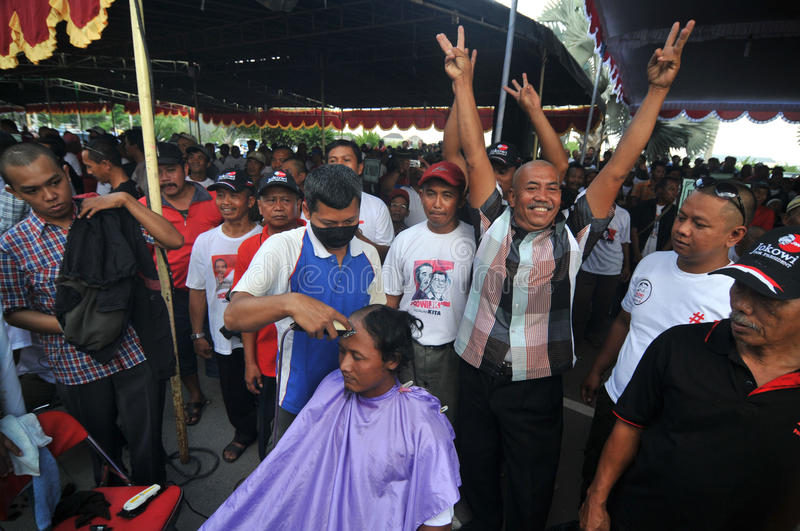 Celebration the victory of Presidential Candidate Joko Widodo. Supporters shave hair to bald to celebrate the victory of Presidential Candidate Joko Widodo in royalty free stock image