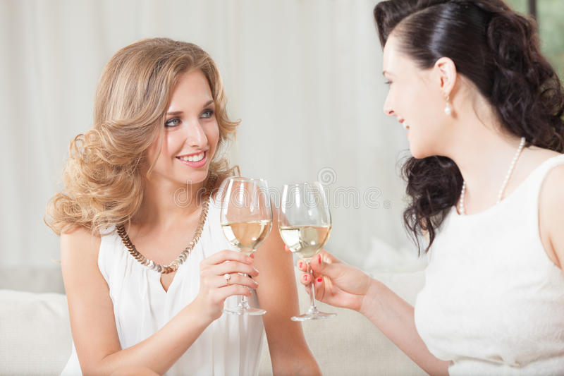 Celebration with wine. Two best friends having good time with glass of wine royalty free stock photo