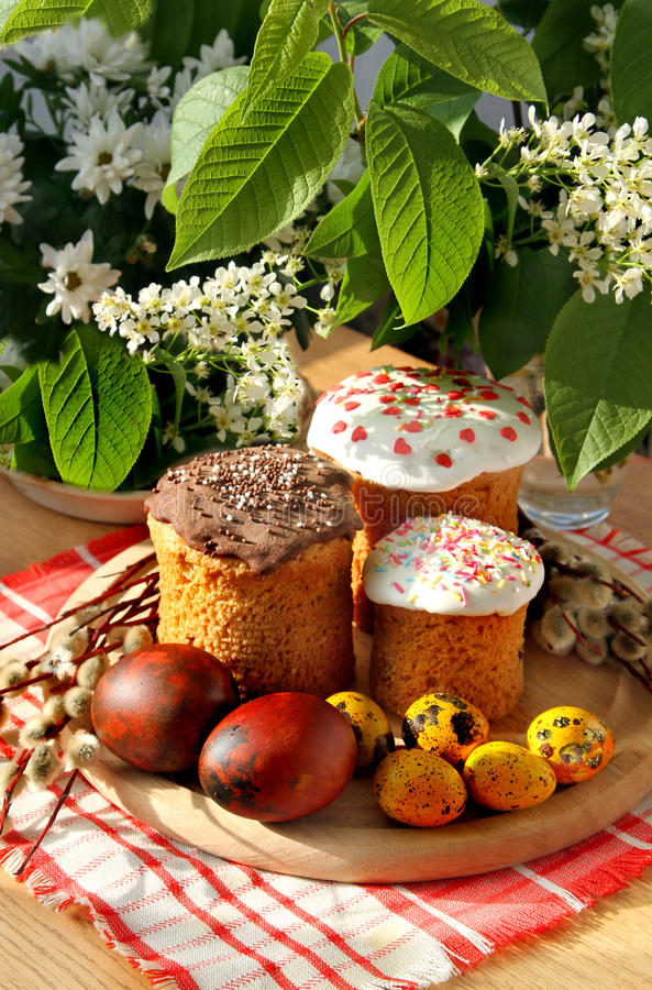 Celebratory Easter bread and eggs. Celebratory Easter bread decoration color eggs and pussy-willow stock photo