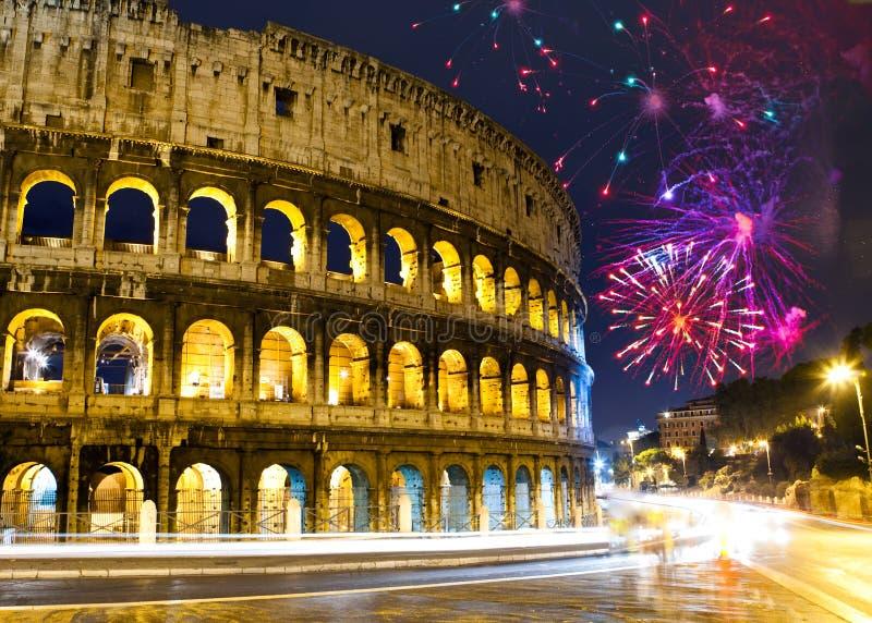 Celebratory fireworks over Collosseo. Italy. Rome. Night city landscape stock image