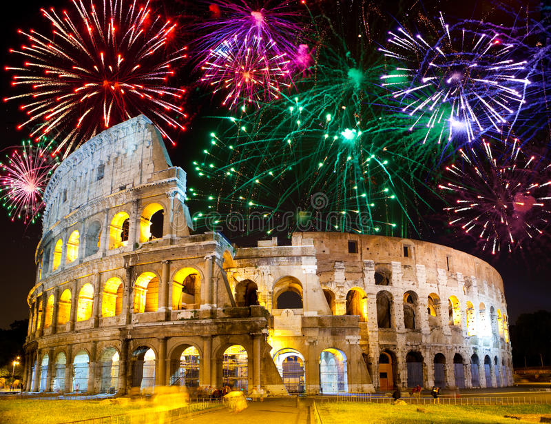 Celebratory fireworks over Collosseo. Italy. Rome. Night city landscape royalty free stock photos