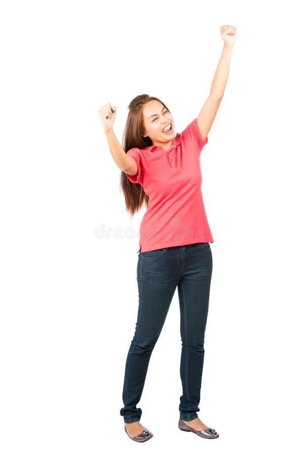 Celebrazione del profilo sollevato pugni asiatici della donna di vittoria immagine stock