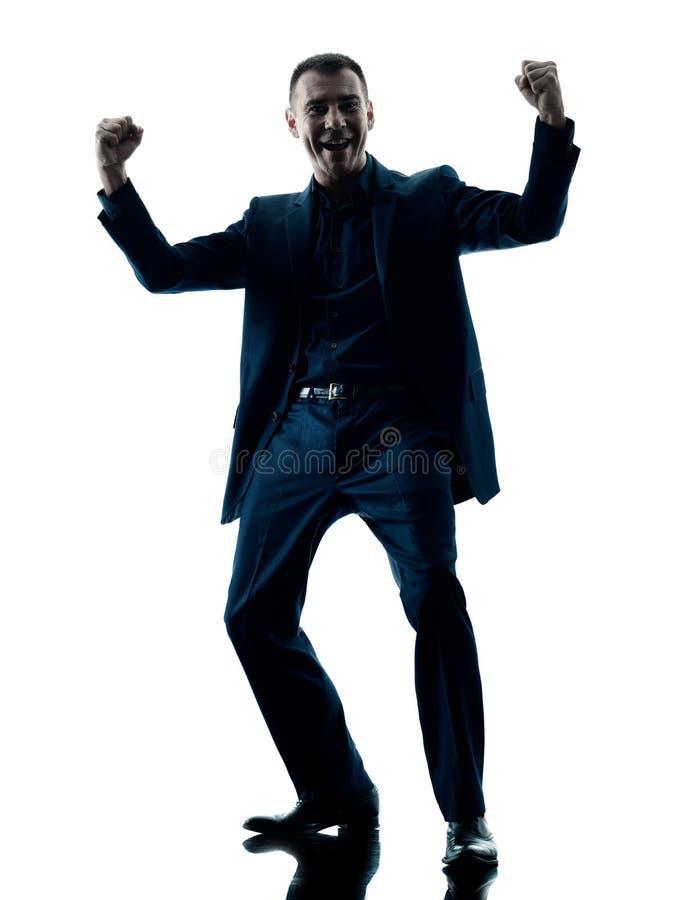 Celebrazione felice dell'uomo di affari isolata fotografie stock