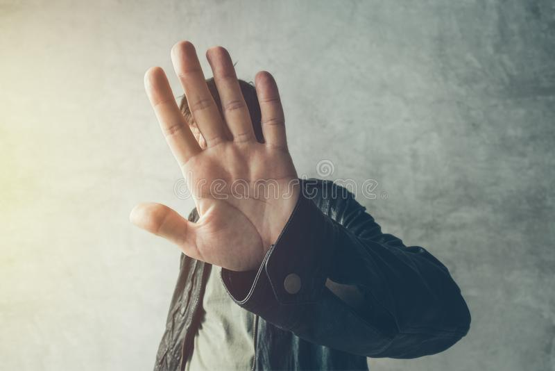 Celebrity male hiding face from paparazzi photographers stock photo
