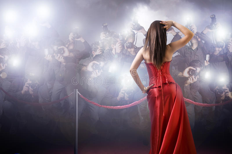 Celebrity posing with paparazzi royalty free stock image
