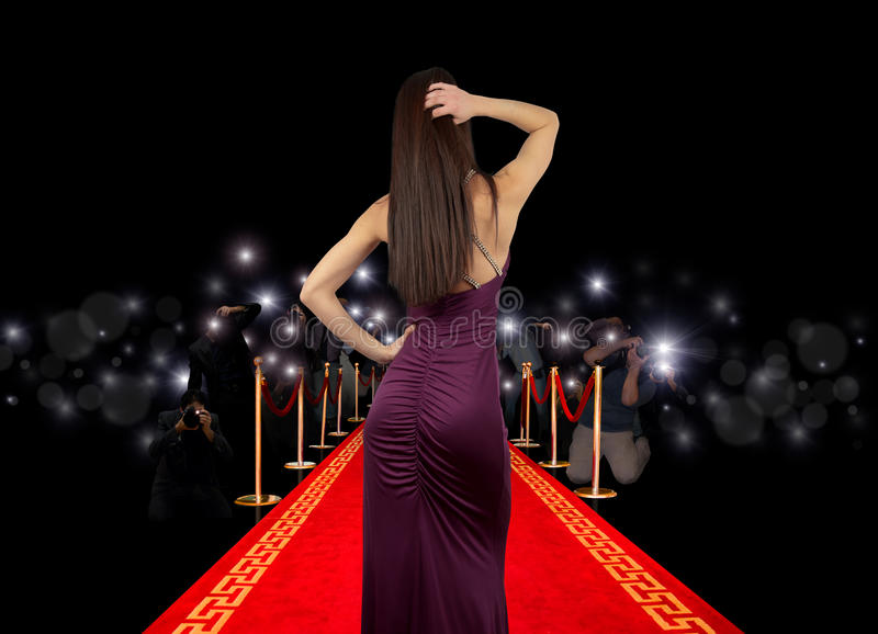 Celebrity on red carpet. With photographer stock image