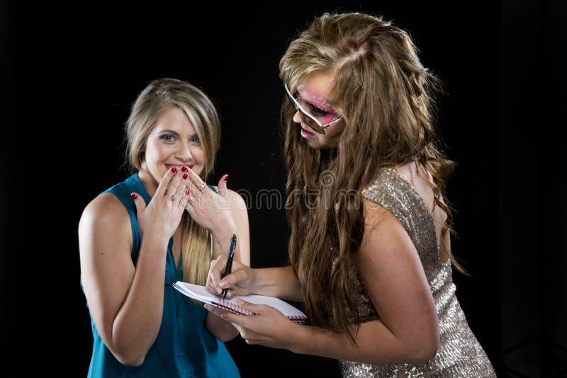 Celebrity signing autographs royalty free stock image