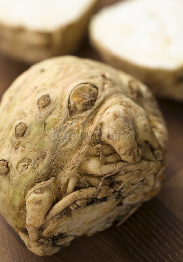 Celeriac. On a wooden surface royalty free stock image