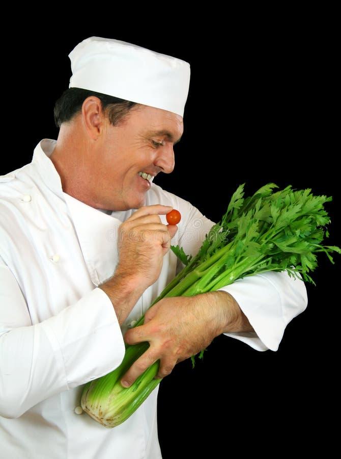 Celery Feeding Chef royalty free stock photos