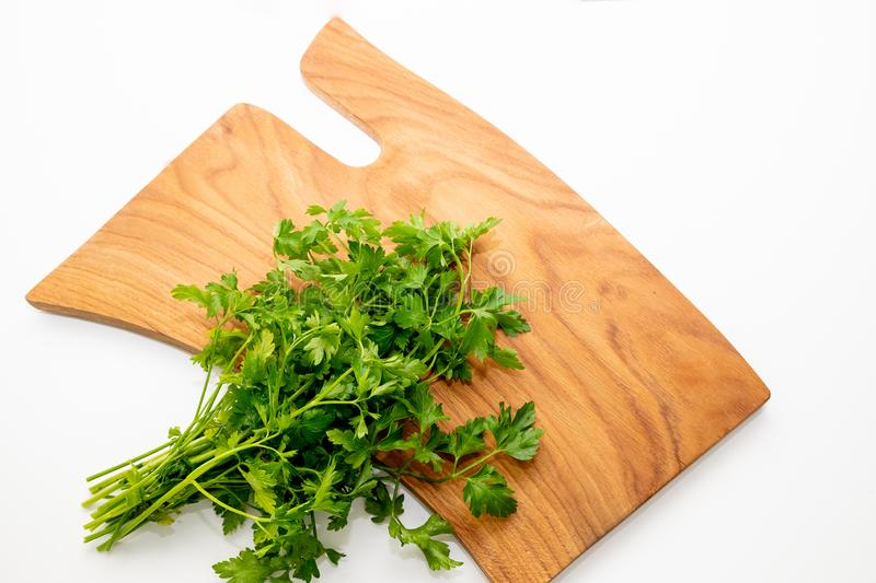 Celery leaves on wooden table. Healthy food.Spicy herbs. Fresh celery. Green celery leaves on wooden cutting board.Fresh stock photography