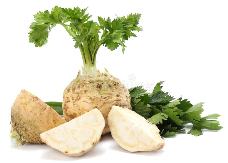 Celery root with leaf isolated on white background. Celery isolated on white. Healthy food royalty free stock photography
