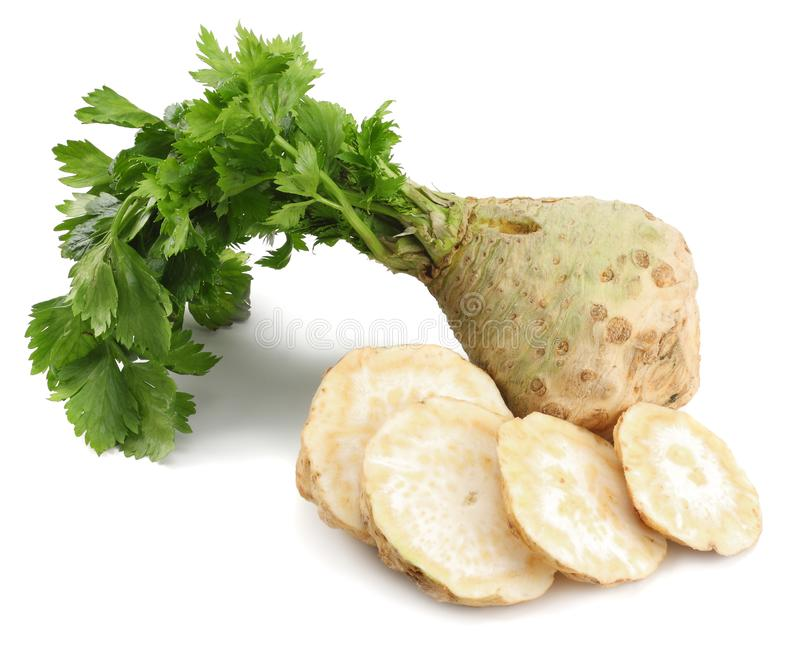 Celery root with leaf isolated on white background. Celery isolated on white. Healthy food royalty free stock image