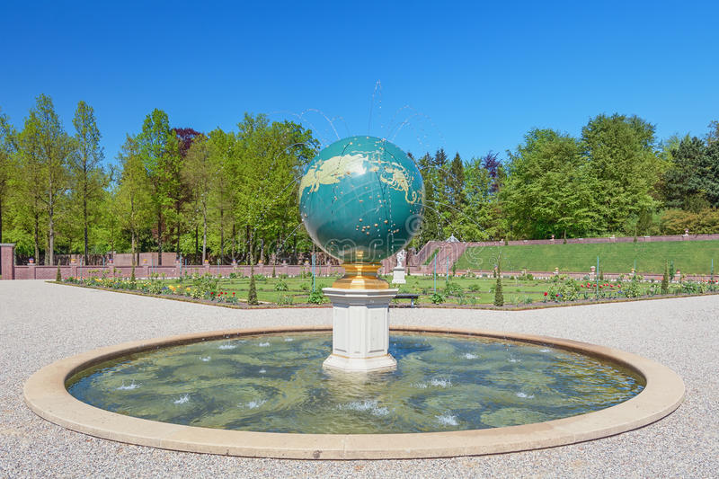 The celestial globe representing the zodiac. Apeldoorn, The Netherlands, May 8, 2016: The excavations in the celestial globe in the place garden Het Loo royalty free stock images