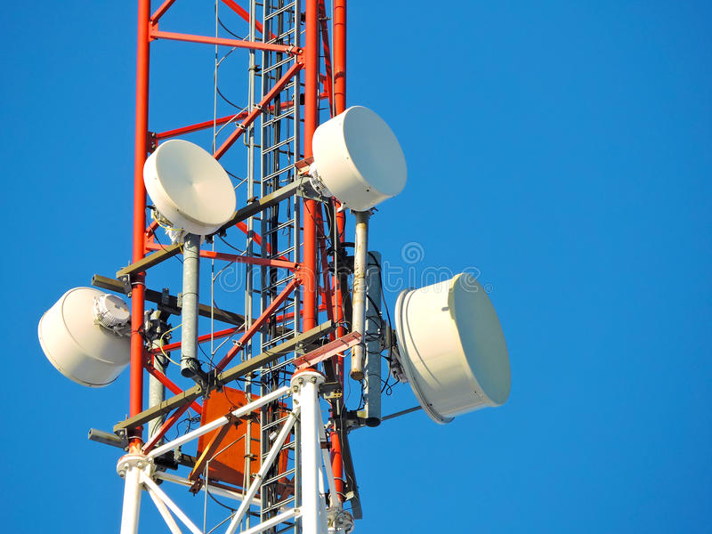 Cell antenna, transmitter. Telecom TV radio mobile tower against blue sky. Telecommunication tower against the blue sky, cell antenna, transmitter. Telecom TV stock photos