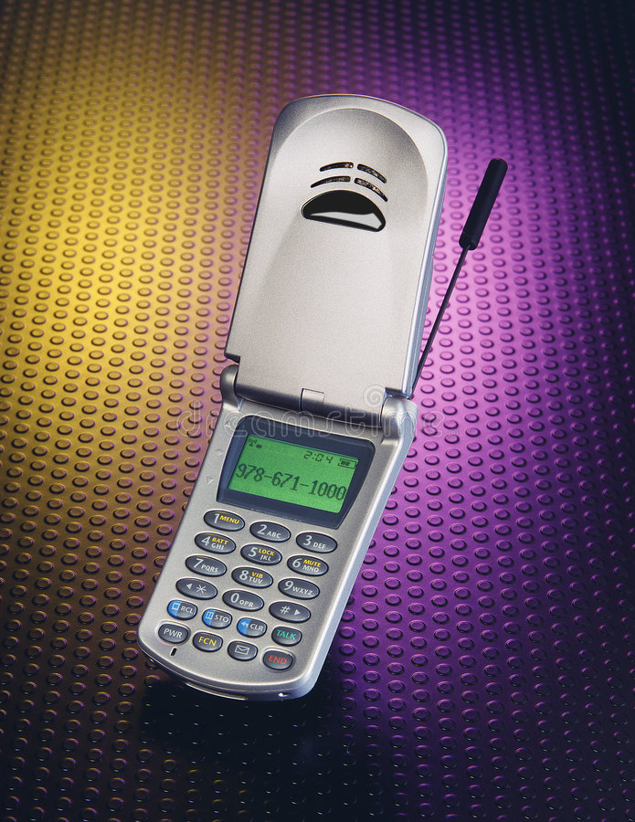 Cell Phone. On yellow and purple designer formica back ground royalty free stock photo