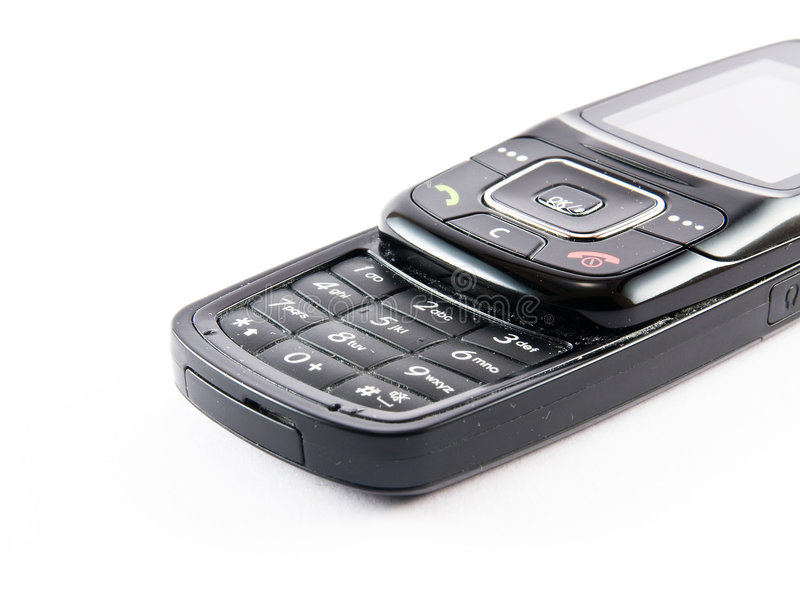 Cell phone. Single cell phone macro close up lightbox digits royalty free stock photo