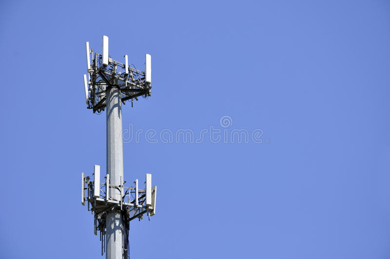Cell phone antenna. In the day light with blue sky in the background stock photo