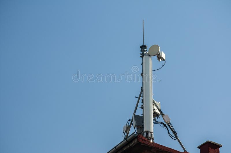 Cell phone antenna. Or aerial tower used for GSM and UMTS mobile phone transmissions royalty free stock photos
