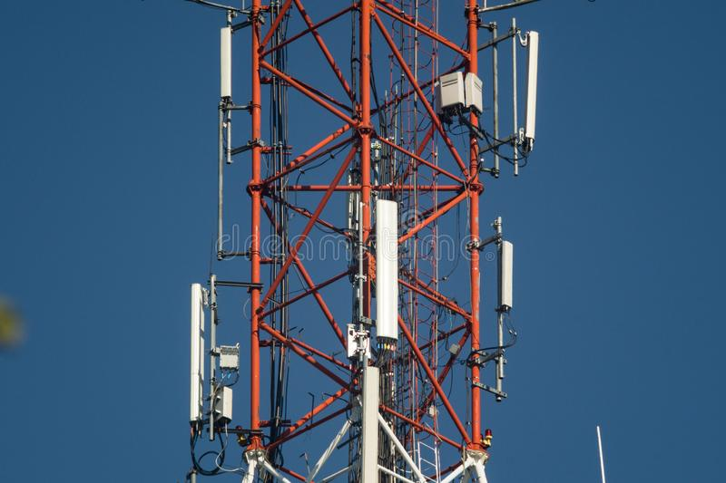 Cell phone antenna tower. Lattice telecommunication tower with microwave and GSM antennas stock photos