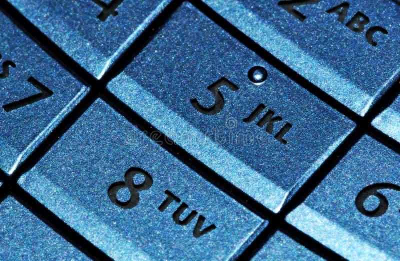 Cell phone blue keypad royalty free stock photo