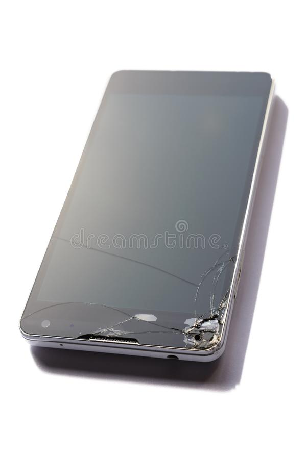 Cell Phone with Broken Screen. Repairs needed after falling to the floor royalty free stock photography