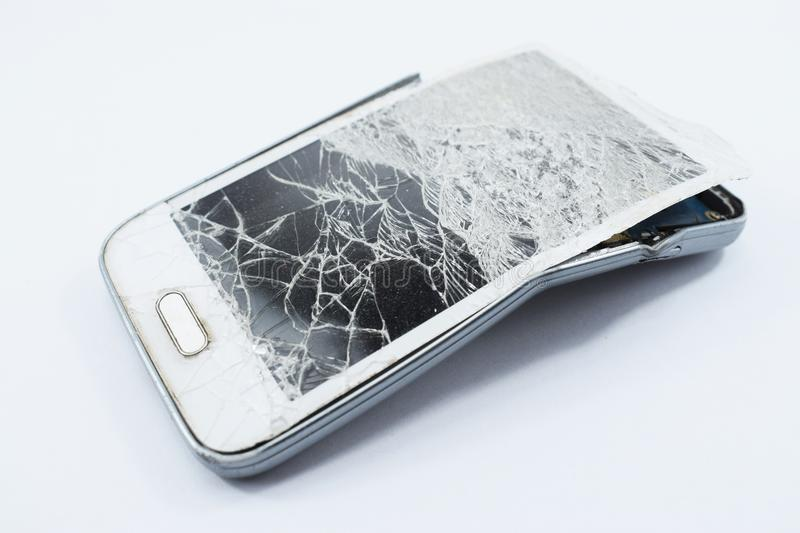 Cell phone broken, on white background. Broken royalty free stock image