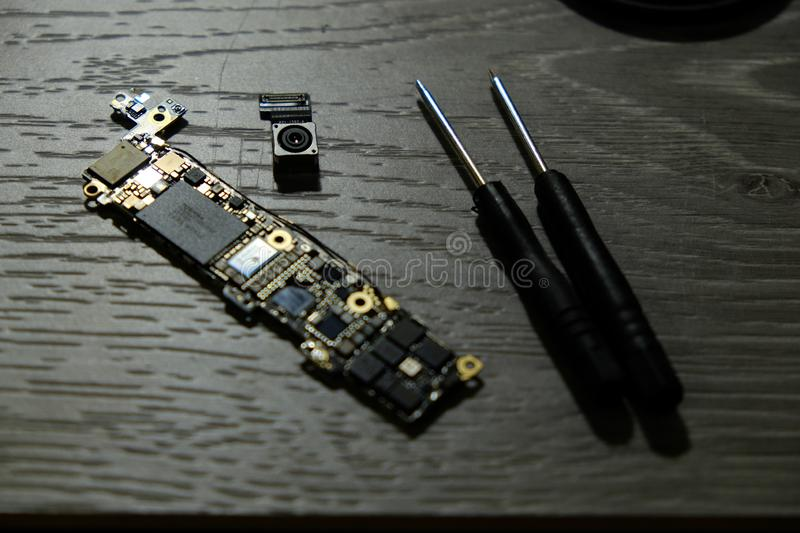 Cell phone camera module with other parts of device, service and repair concept royalty free stock photo